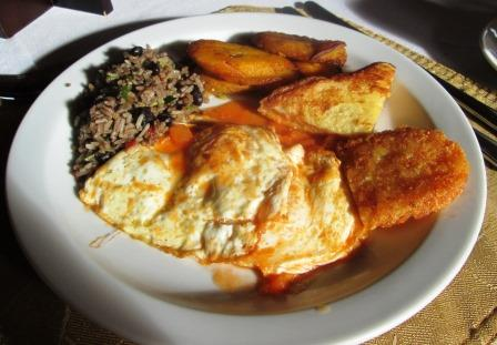 Fried eggs, gallo pinto, plantains, ham & cheese sandwich, potato cake