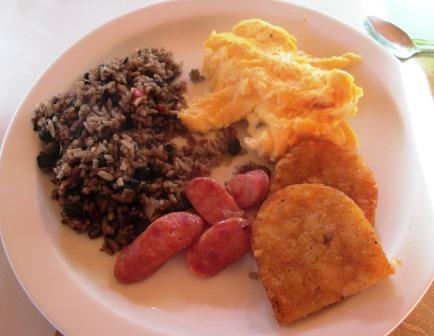 Gallo pinto, scrambled eggs, potato cakes, sausages