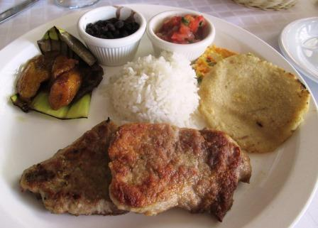 Chicken berast, plantains, rice, beans, tomatoes, vegetable frittata, tortilla